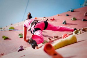 A girl doing wall Climbing at PLaY