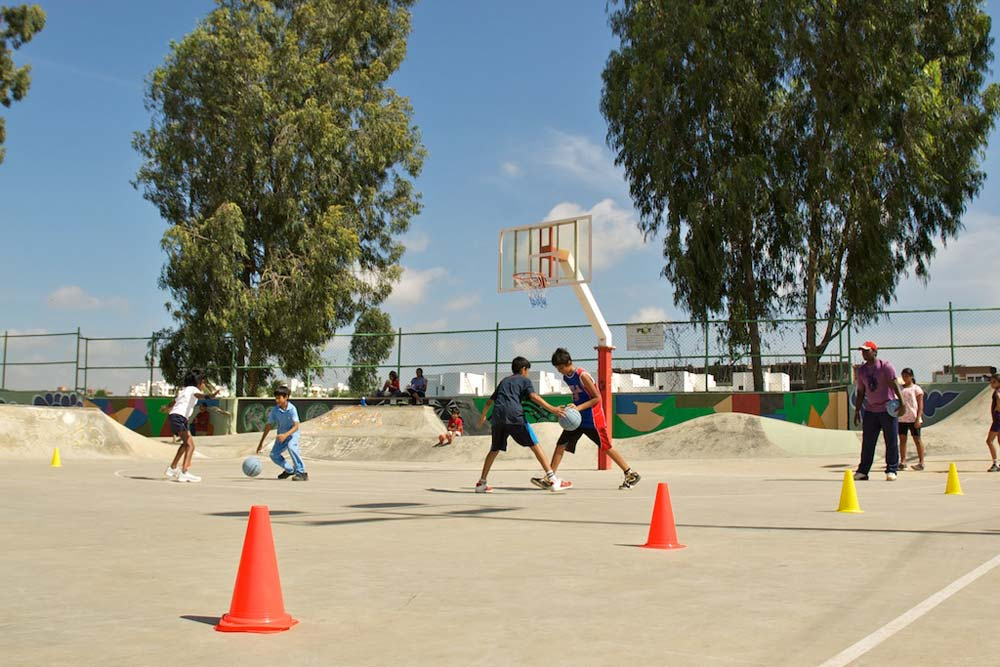 People engaged in Playing Basketball at Play