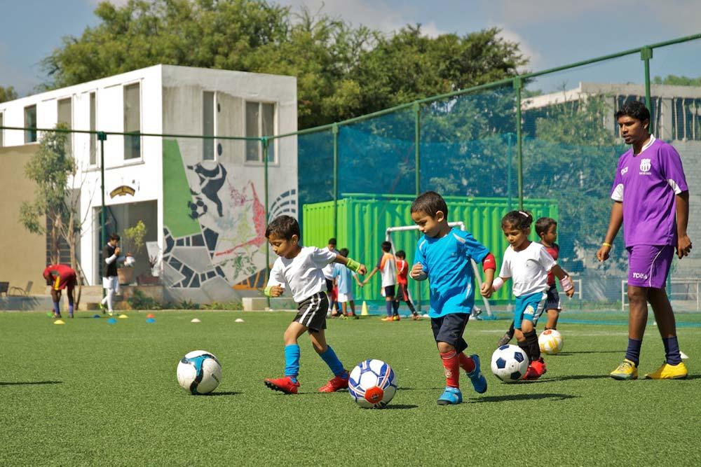 Kids Playing Football at Play Arena