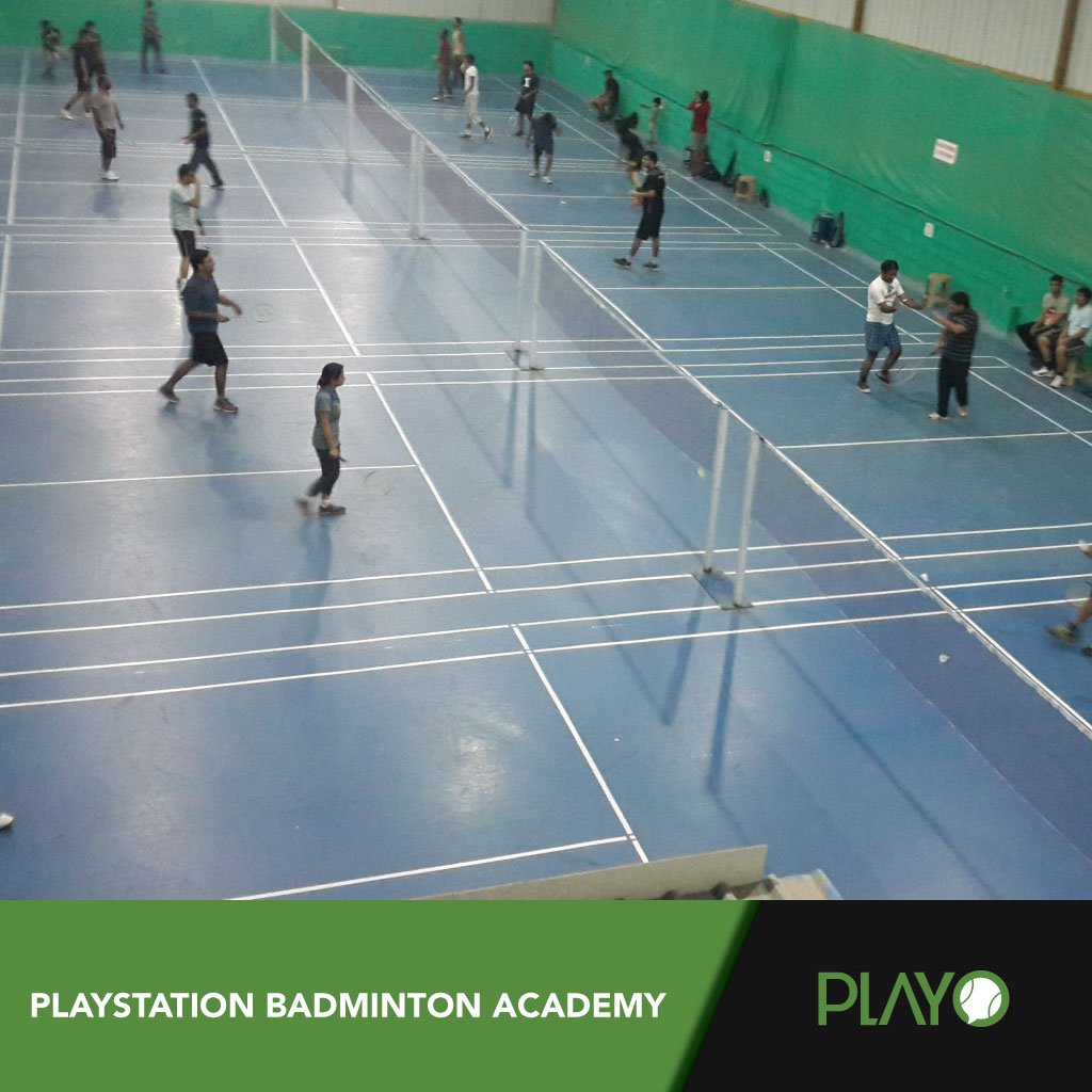 Players playing badminton at playstation academy. On their 12 badminton courts.