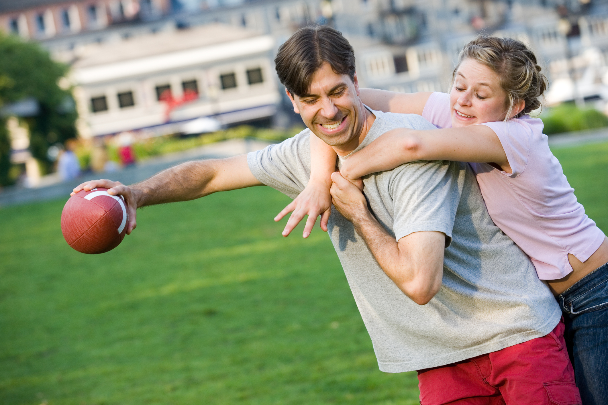 Couple-Playing-Football