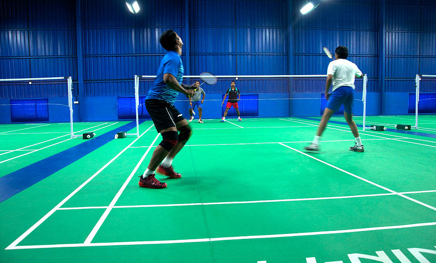 A Badminton doubles match in progress at Badminton