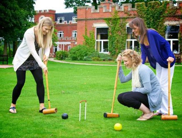 women playing croquet
