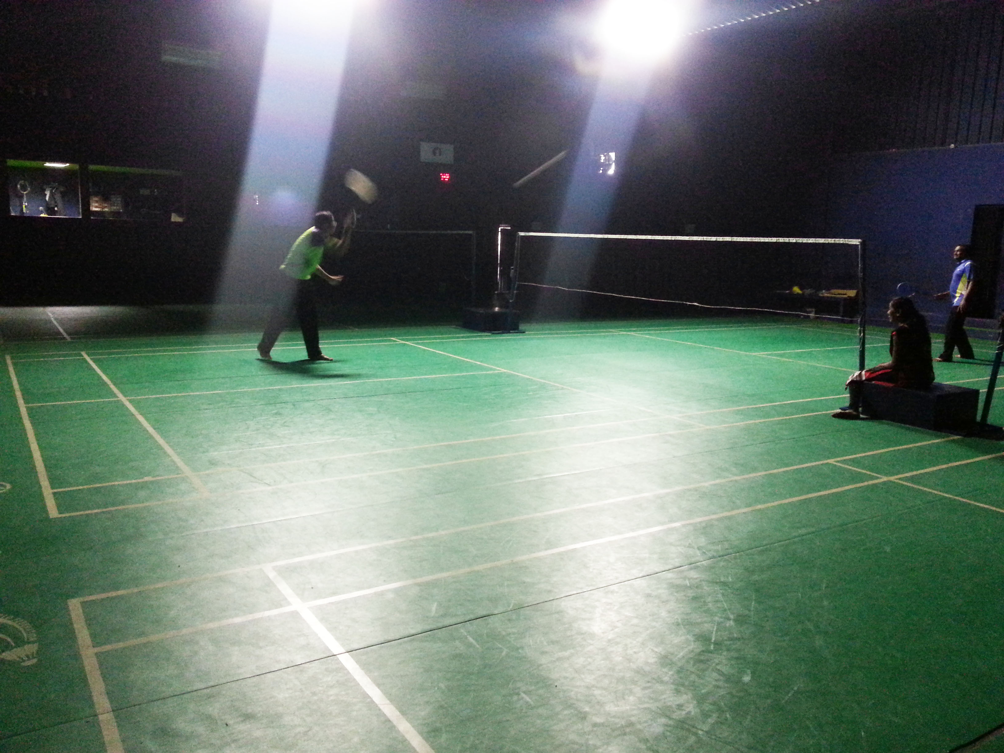 Badminton courts being engaged by players