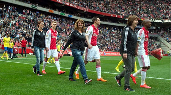 Ajax Players walk out with their mothers ahead of their final home game at Cambuur