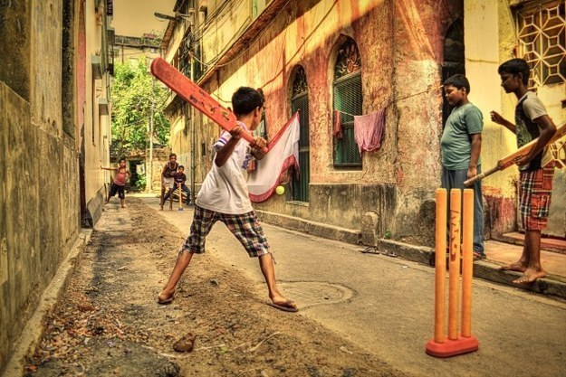 Children playing cricket on the streets