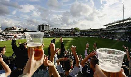 cricket fans with beer