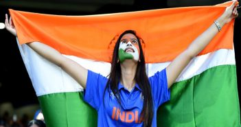 a cricket fan cheering for india