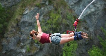 a girl bungee jumping