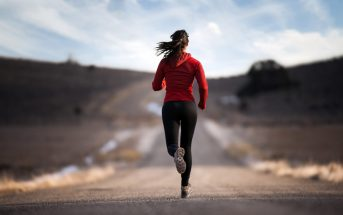 a lady running on the road