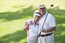 Senior couple playing golf