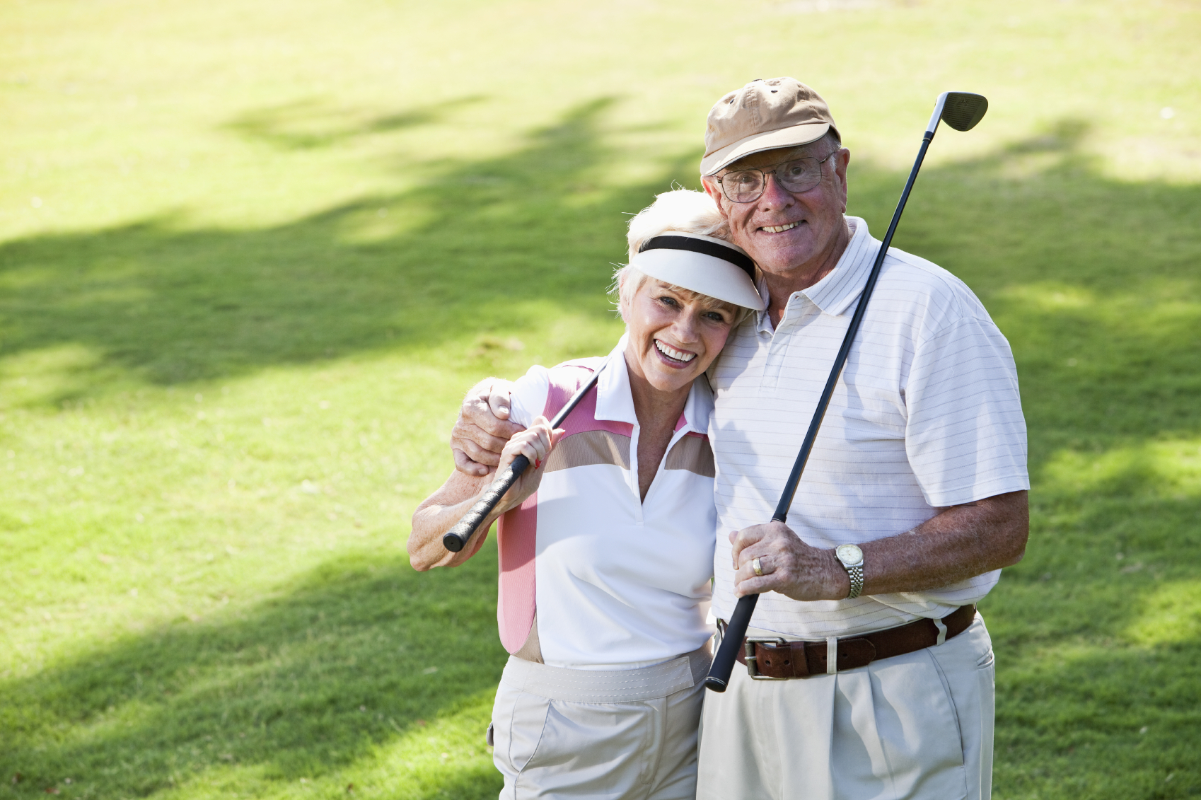 Mature Couple Sitting In Golf Buggy On Golf Course, Man