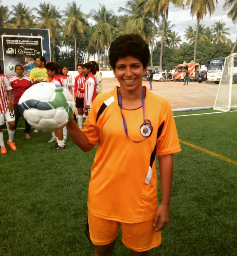 Aloka posing with the Football