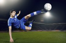 Football player volleying ball 18836852