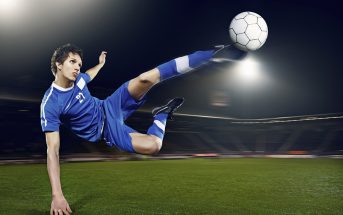Football player volleying ball 18836852
