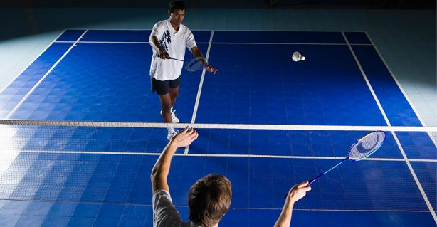 two people playing badminton