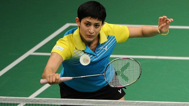 ashwini ponnappa with her badminton racket