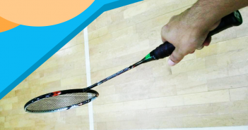 holding badminton racket
