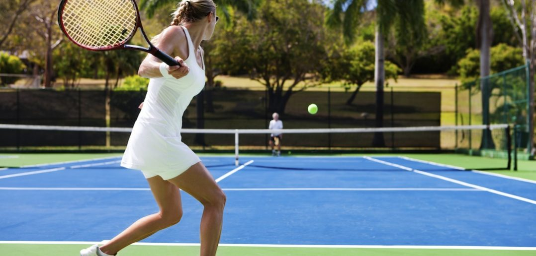 people playing tennis in tropics
