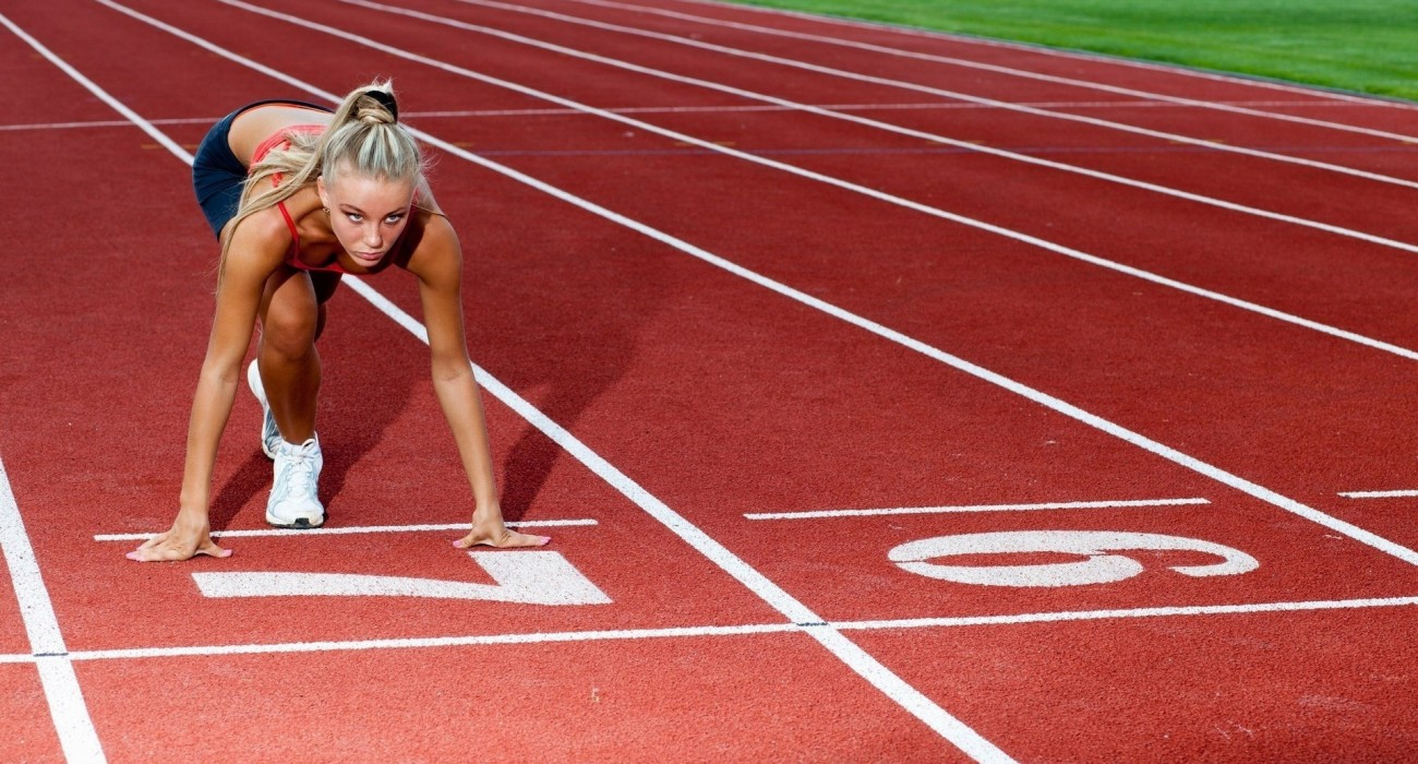 lady focusing on the running track