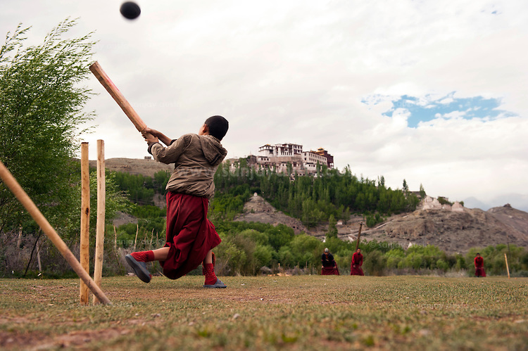 a monk playing cricket