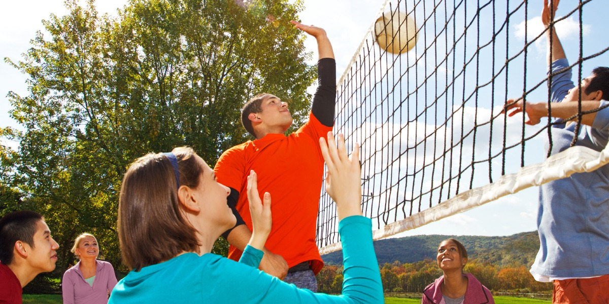 playing volleyball happy friends