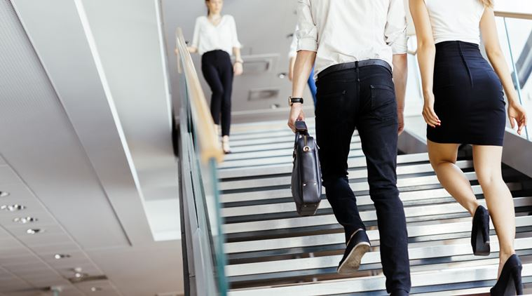 Group of businessman walking and taking stairs