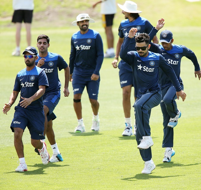 ADELAIDE, AUSTRALIA - NOVEMBER 23: Players warm up during a training session for the Indian cricket team at Gliderol Stadium on November 23, 2014 in Adelaide, Australia. (Photo by Morne de Klerk/Getty Images)- cricket Warm-up