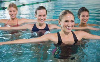 women doing pre and post swim exercises