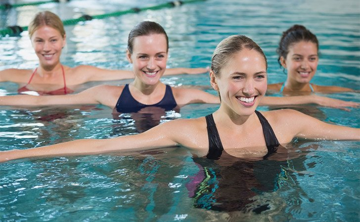 women doing pre and post swim exercises