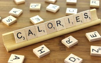 A scrabble board showing the word calories.
