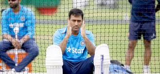 Dhoni making hand gestures