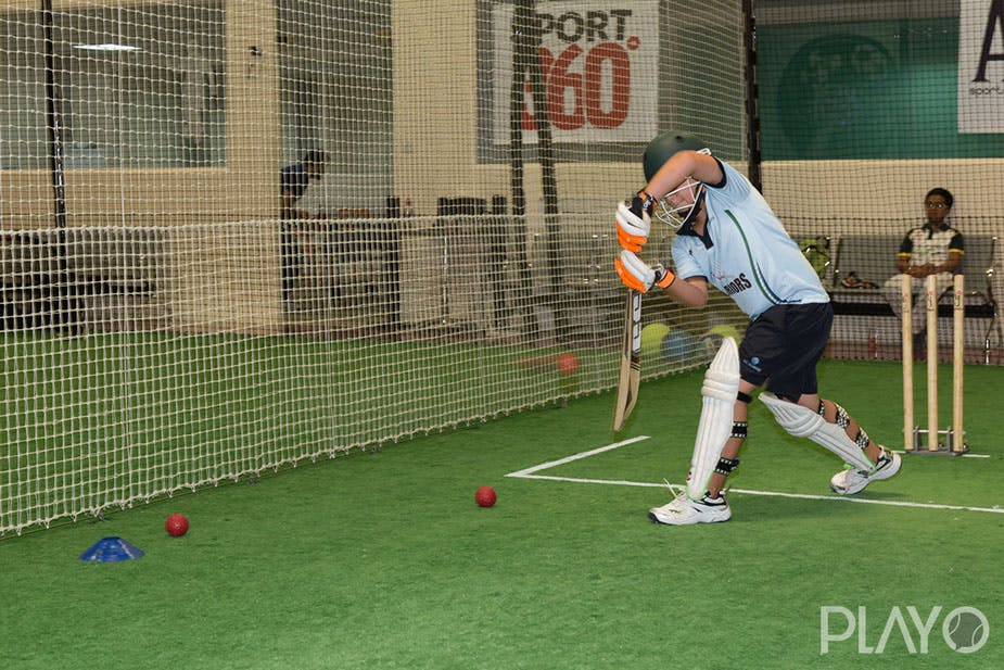 A man playing Cricket in Cover Drive Sports Academy
